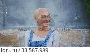 Купить «Mixed race woman smiling at the camera», видеоролик № 33587989, снято 10 января 2020 г. (c) Wavebreak Media / Фотобанк Лори