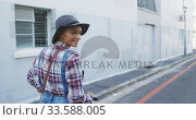 Купить «Mixed race woman using electric scooter», видеоролик № 33588005, снято 10 января 2020 г. (c) Wavebreak Media / Фотобанк Лори