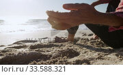 Купить «Senior man touching the sand», видеоролик № 33588321, снято 21 ноября 2019 г. (c) Wavebreak Media / Фотобанк Лори