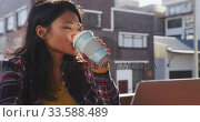 Купить «Mixed race woman working on laptop», видеоролик № 33588489, снято 23 февраля 2020 г. (c) Wavebreak Media / Фотобанк Лори