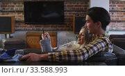Купить «Happy couple spending time together in their house », видеоролик № 33588993, снято 8 июля 2019 г. (c) Wavebreak Media / Фотобанк Лори