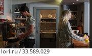 Купить «Happy couple spending time together in their house », видеоролик № 33589029, снято 8 июля 2019 г. (c) Wavebreak Media / Фотобанк Лори
