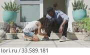 African american girl tying her father shoes . Стоковое видео, агентство Wavebreak Media / Фотобанк Лори