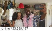 Купить «African american father and daughter disguised and taking selfie », видеоролик № 33589197, снято 14 января 2020 г. (c) Wavebreak Media / Фотобанк Лори