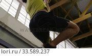 Купить «Low angle view of an athletic Caucasian man climbing up a rope», видеоролик № 33589237, снято 30 июля 2019 г. (c) Wavebreak Media / Фотобанк Лори