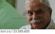 Купить «Senior man in social distancing looking at camera», видеоролик № 33589605, снято 22 ноября 2018 г. (c) Wavebreak Media / Фотобанк Лори