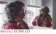 Купить «A senior african american woman spending time at home taking care of herself  social distancing in q», видеоролик № 33590121, снято 12 ноября 2019 г. (c) Wavebreak Media / Фотобанк Лори