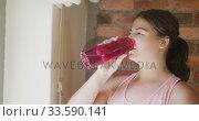 Caucasian vlogger woman drinking water at home. Стоковое видео, агентство Wavebreak Media / Фотобанк Лори