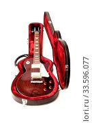 Купить «Guitar in open case isolated on the white background», фото № 33596077, снято 14 июля 2020 г. (c) easy Fotostock / Фотобанк Лори