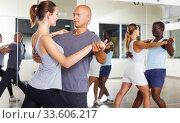 dancing couples enjoying slow foxtrot. Стоковое фото, фотограф Яков Филимонов / Фотобанк Лори