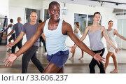 Купить «People dancing lindy hop during group training», фото № 33606237, снято 30 июля 2018 г. (c) Яков Филимонов / Фотобанк Лори