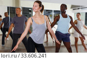 Купить «Group of active young people enjoying dancing together in studio», фото № 33606241, снято 30 июля 2018 г. (c) Яков Филимонов / Фотобанк Лори