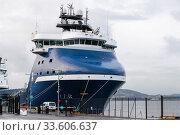 Huge blue supply vessel is moored in port of Bergen (2017 год). Стоковое фото, фотограф EugeneSergeev / Фотобанк Лори