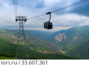 Cableway and support against the backdrop of the picturesque mountains of Armenia near the Tatev Monastery - a landmark of Armenia. Стоковое фото, фотограф Константин Лабунский / Фотобанк Лори