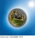 Купить «Aerial city view with crossroads and roads, houses, buildings, parks and parking lots, bridges. Copter shot. Little planet sphere mode.», фото № 33608113, снято 1 июня 2020 г. (c) age Fotostock / Фотобанк Лори