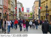 Купить «Crowd on Grodzka Street Old Town Krakow Poland near St. Peter and Paul Cathedral Europe EU.», фото № 33608689, снято 4 мая 2019 г. (c) age Fotostock / Фотобанк Лори