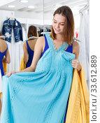 Woman trying dress in fitting room. Стоковое фото, фотограф Яков Филимонов / Фотобанк Лори