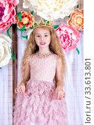 Portrait of girl dressed as princess with diamond diadem on the background of flower. Стоковое фото, фотограф Евгений Ткачёв / Фотобанк Лори