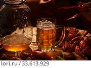Купить «Crayfish with beer on a wooden table», фото № 33613929, снято 20 апреля 2020 г. (c) Марина Володько / Фотобанк Лори