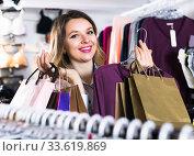 Купить «female shopper examining long sleeve shirts in underwear shop», фото № 33619869, снято 20 марта 2017 г. (c) Яков Филимонов / Фотобанк Лори