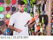Купить «sportsman choosing tennis racquet», фото № 33619981, снято 6 февраля 2018 г. (c) Яков Филимонов / Фотобанк Лори