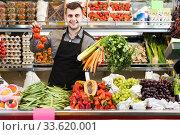 Купить «shopping assistant demonstrating assortment of grocery shop», фото № 33620001, снято 18 марта 2017 г. (c) Яков Филимонов / Фотобанк Лори