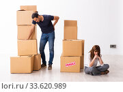 Купить «Young pair and many boxes in divorce settlement concept», фото № 33620989, снято 3 сентября 2019 г. (c) Elnur / Фотобанк Лори