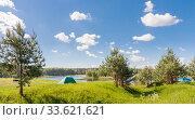 Купить «Tent on the lake at summer», фото № 33621621, снято 2 июня 2019 г. (c) Дмитрий Тищенко / Фотобанк Лори