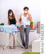Купить «Young woman doing ironing for her husband», фото № 33622553, снято 27 июня 2018 г. (c) Elnur / Фотобанк Лори