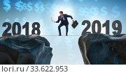 Купить «Businessman balancing between 2018 and 2018 years», фото № 33622953, снято 5 июля 2020 г. (c) Elnur / Фотобанк Лори