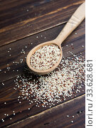 Organic quinoa grains in wooden spoon, Gluten free. Concept Healthy food. Diet. Стоковое фото, фотограф Papoyan Irina / Фотобанк Лори