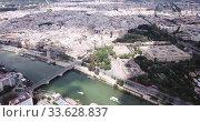 Купить «Aerial view Sevilla of city center with embankment of Guadalquivir. Spain», видеоролик № 33628837, снято 19 апреля 2019 г. (c) Яков Филимонов / Фотобанк Лори