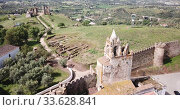 Купить «Panoramic view from drone of the castle Montemor o Novo. The Alcaides palace ruins. Evora district. Alentejo, Portugal», видеоролик № 33628841, снято 20 апреля 2019 г. (c) Яков Филимонов / Фотобанк Лори