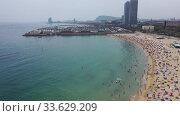 Купить «Scenic view from drone of seaside area of Barcelona on sunny summer day, Catalonia», видеоролик № 33629209, снято 7 июля 2019 г. (c) Яков Филимонов / Фотобанк Лори