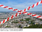 Купить «Coronavirus in Paris, France. Covid-19 sign on a blurred background. Concept of COVID pandemic and travel in Europe. The city skyline at daytime.», фото № 33633689, снято 10 апреля 2020 г. (c) Владимир Журавлев / Фотобанк Лори
