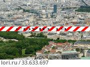 Купить «Coronavirus in Paris, France. Covid-19 sign on a blurred background. Concept of COVID pandemic and travel in Europe. The city skyline at daytime.», фото № 33633697, снято 10 апреля 2020 г. (c) Владимир Журавлев / Фотобанк Лори