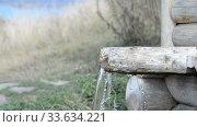 Купить «Spring water, wooden well source clear water», видеоролик № 33634221, снято 25 апреля 2020 г. (c) Mikhail Erguine / Фотобанк Лори
