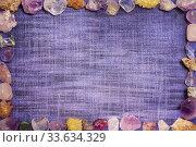 Rectangular frame made up of various semi precious rocks on the fabric texture. Стоковое фото, фотограф Федонников Никита Александрович / Фотобанк Лори