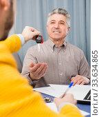 Купить «Mature and manager sign contract car lease», фото № 33634865, снято 5 июня 2020 г. (c) Яков Филимонов / Фотобанк Лори