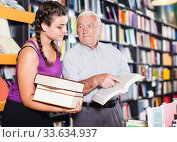 elderly man and granddaughter discuss a book. Стоковое фото, фотограф Яков Филимонов / Фотобанк Лори