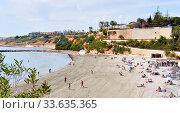 Купить «People spend on the Cabo Roig beach. Costa Blanca, Spain», фото № 33635365, снято 13 марта 2020 г. (c) Alexander Tihonovs / Фотобанк Лори