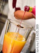Купить «Barmen makes cocktail closeup image», фото № 33635389, снято 24 февраля 2020 г. (c) Alexander Tihonovs / Фотобанк Лори