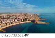 Купить «Aerial panorama of Torrevieja cityscape. Costa Blanca. Spain», фото № 33635401, снято 10 марта 2020 г. (c) Alexander Tihonovs / Фотобанк Лори