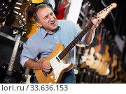 Male is playing on electric guitar. Стоковое фото, фотограф Яков Филимонов / Фотобанк Лори