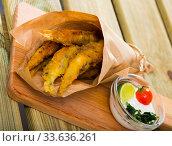 Купить «Fish and chips with creamy cheese sauce», фото № 33636261, снято 23 августа 2018 г. (c) Яков Филимонов / Фотобанк Лори
