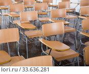 Купить «Wooden chairs in rows in classroom of school interior, no people», фото № 33636281, снято 25 июля 2018 г. (c) Яков Филимонов / Фотобанк Лори