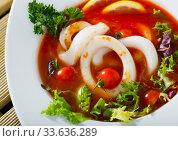 Купить «Spicy tomato soup with sea squids and greens served in a white bowl», фото № 33636289, снято 13 июля 2020 г. (c) Яков Филимонов / Фотобанк Лори