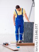 Купить «The young male contractor working indoors», фото № 33646017, снято 9 июля 2020 г. (c) easy Fotostock / Фотобанк Лори