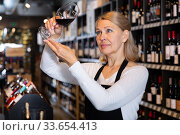 Woman wine producer inspecting quality of wine. Стоковое фото, фотограф Яков Филимонов / Фотобанк Лори