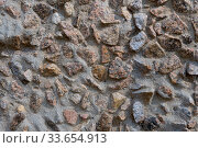 Купить «Close-up - gray-brown stone wall in the old facade of the house», фото № 33654913, снято 2 июня 2020 г. (c) Pavel Biryukov / Фотобанк Лори